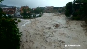 Floodwaters race downstream after torrential rainfall