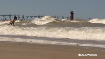 Red flags wave, warning of dangerous swim conditions