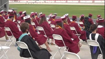 High school seniors cross the finish line at racetrack graduation
