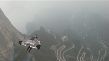 Watch These Two  Wingsuit Flyers Zoom Through A Cave Opening, Wowing Onlookers!