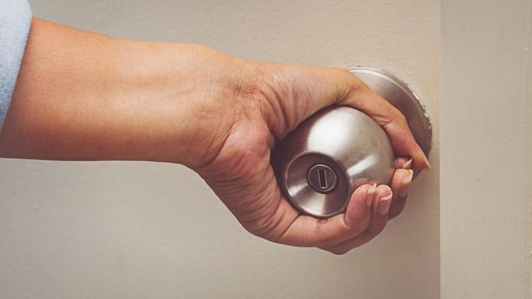 Asian women hand open door knob