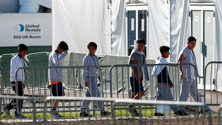 Children line up to enter a tent at the Homestead Temporary Shelter for Unaccompanied Children in Florida