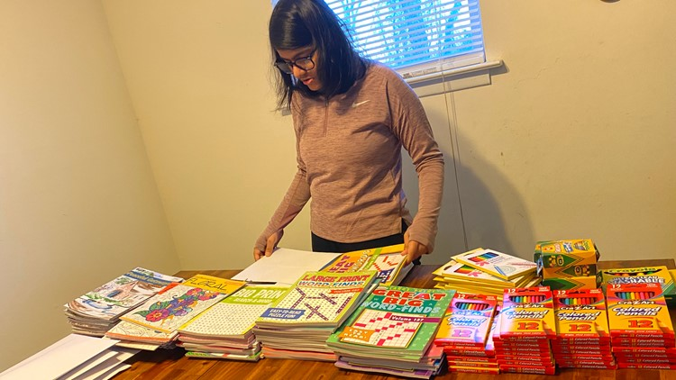 Hita Gupta with coloring books