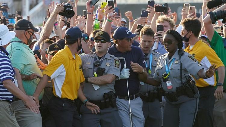 Koepka says injured knee hurt by fans rushing to see Mickelson make history at PGA