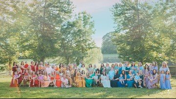 After infertility battle, photographer gathers 79 mothers and 'rainbow babies' for breathtaking photoshoot
