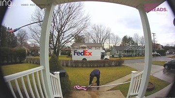 FedEx driver folds flag