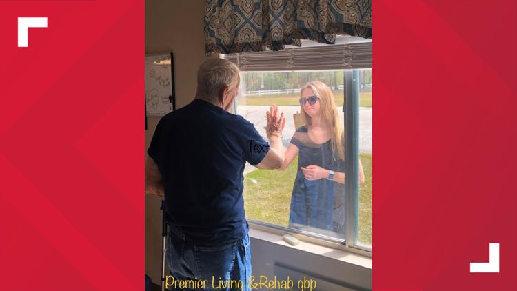 women greets grandfather through nursing home window