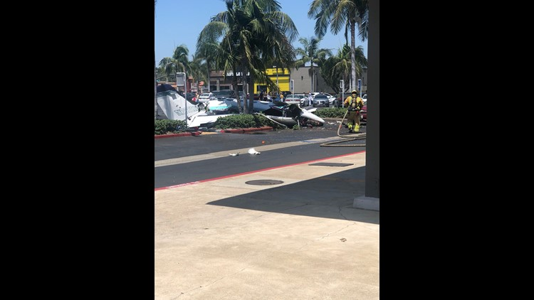 A small twin-engine Cessna bound for John Wayne Airport in Orange County crashed into the parking lot of a Staples office supply store on Sunday killing all five people aboard Orange County fire officials said