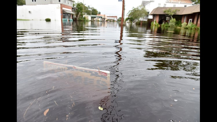 Rivers approached record flood stage and more than 650,000 utility customers were without power Sunday as North Carolina was battered by Florence