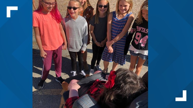 Claire Elliott was welcomed with open arms at the first day of school at Eagle Elementary School of the Arts.