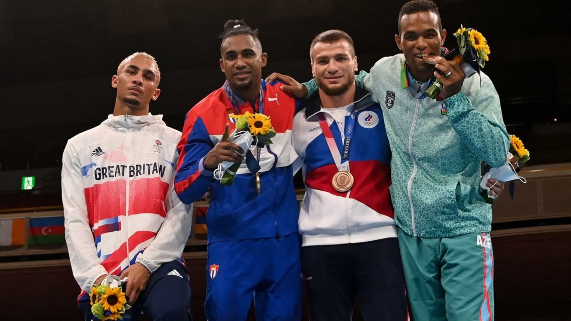 Boxer regrets putting silver medal in his pocket at podium ceremony