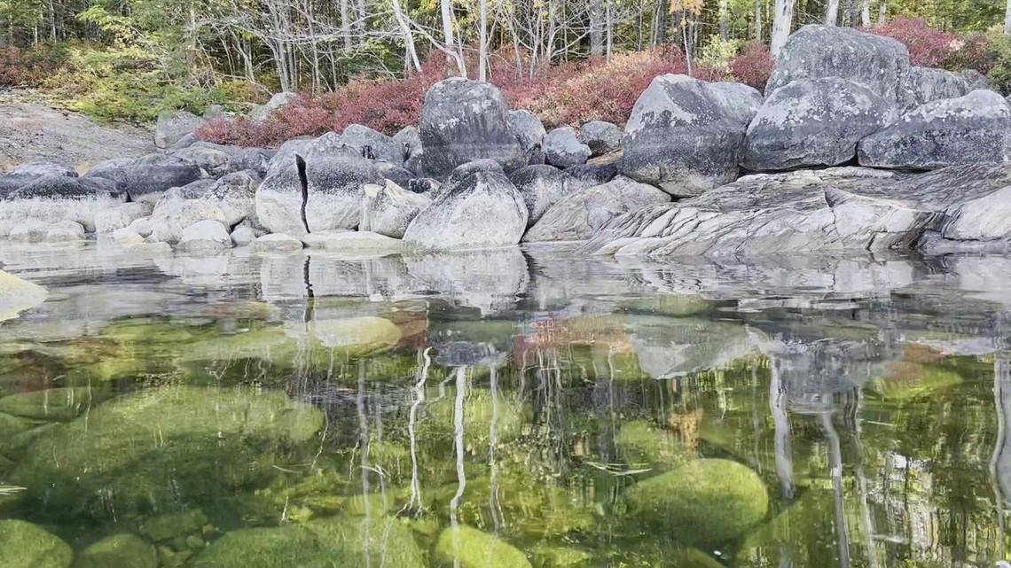 Kayaking Sebago Lake crystal clear rocks and foliage