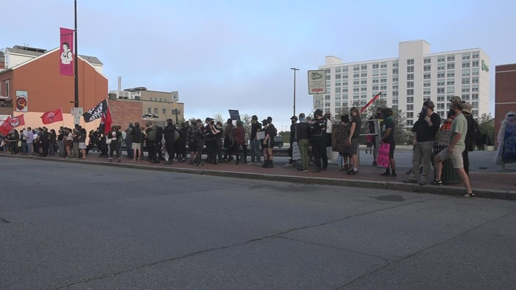Protesters gather outside Mathew's Pub in Portland