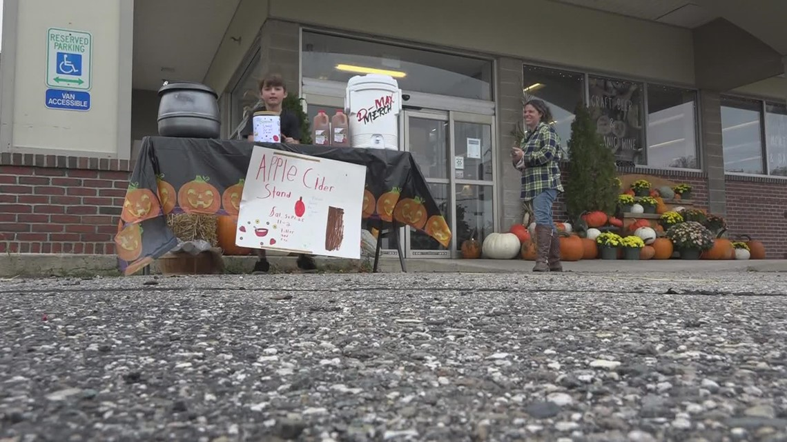 Boy starts apple cider stand to help feed fellow classmates