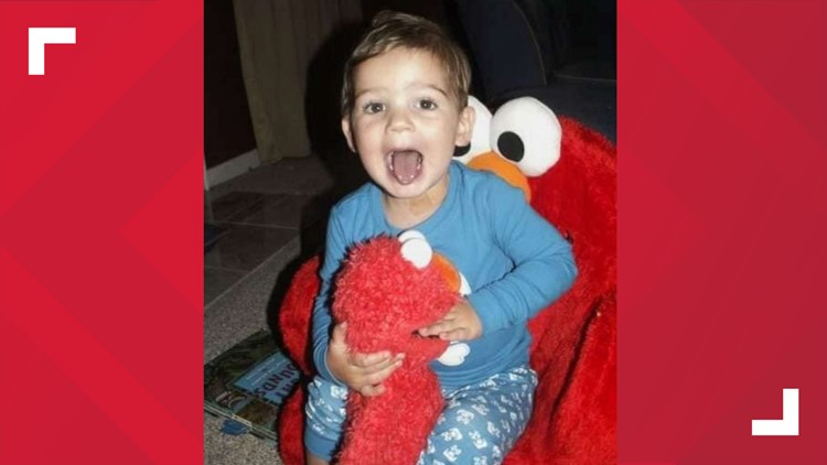 "Tucker and his ""Melmo"" sitting in his Elmo chair"
