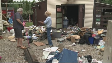 Saco couple cleaning up after fire