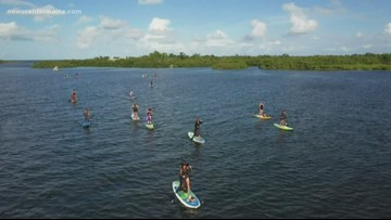 Florida witches trade in their brooms for paddleboards