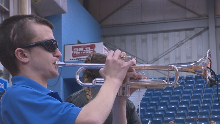 Despite vision loss, Lawrence trumpeter rocks the tournament