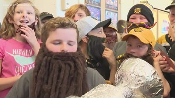 Kids in Auburn rock Bruins playoff beards