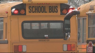 Auburn elementary school bus hit while dropping kids off