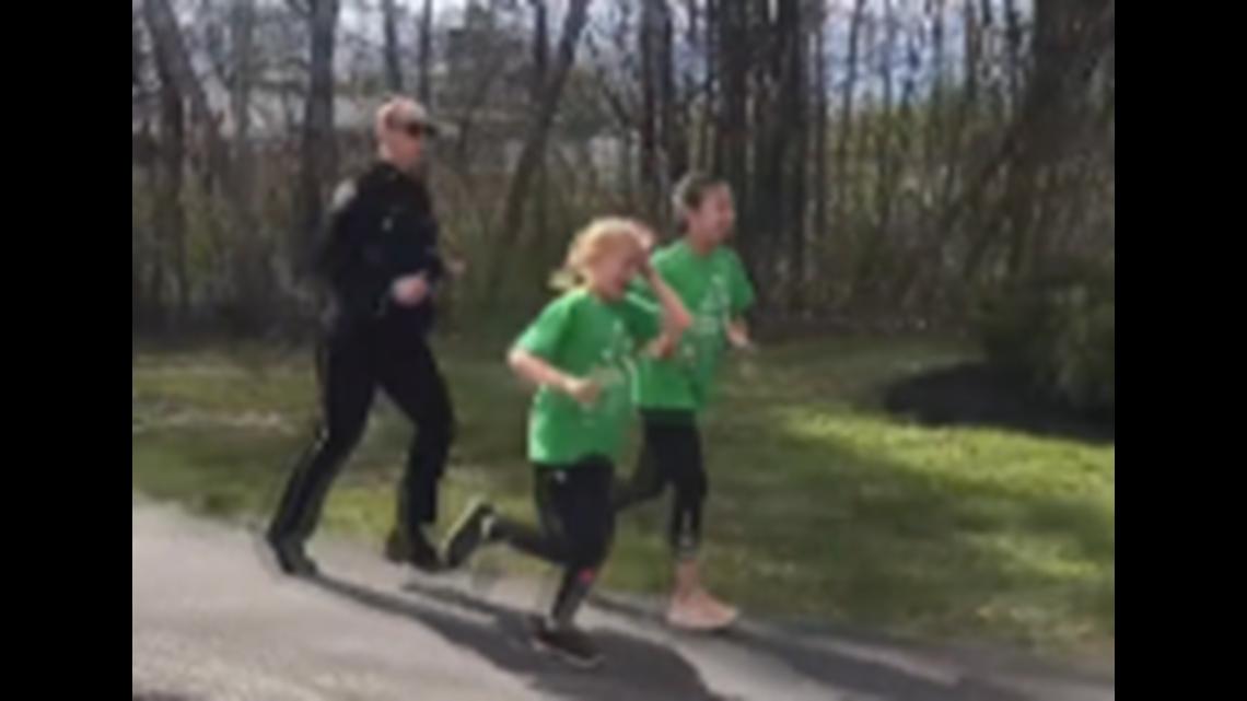 Gorham Police officer runs alongside 'Girls on the Run'