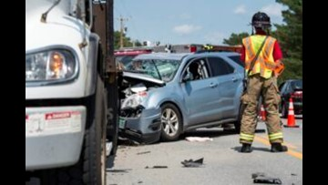 SUV crashes into parked flatbed truck in Winslow, injuring 1