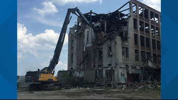 Sanford mill gutted by fire is being demolished, piece by piece