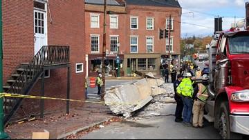 Truck hauling steel beam tips over in downtown Gardiner