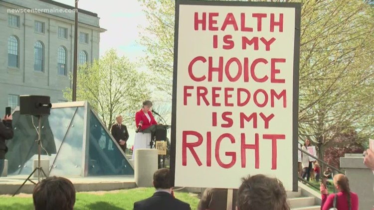 Rally held outside State House to protest vaccine bill