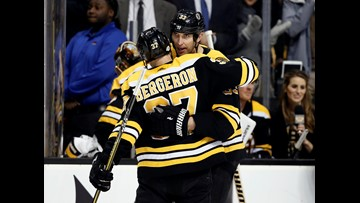 Bergeron, Nash leads Bruins past Flames 5-2