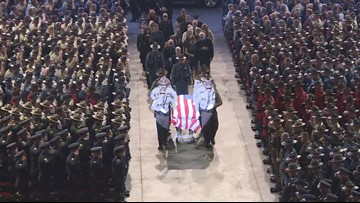 Thousands of mourners pay final respects to Cpl. Eugene Cole