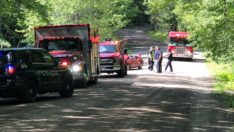 One person got out on their own and two others were rescued by emergency crews, an official said.
