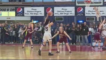 Class A high school basketball teams battle in the state championship