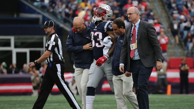 Hill injured his knee while trying to tackle a Texan after a Gronkowski fumble.