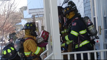South Portland firefighters salvage presents from house fire