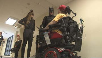 Batman and Catwoman visit patients at New England Rehab
