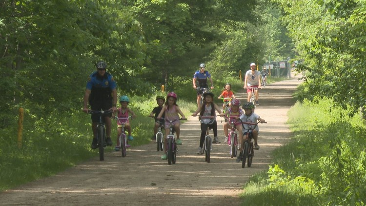 Community rides bikes with Biddeford Police officers in