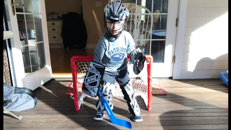 Hunter Barr playing hockey