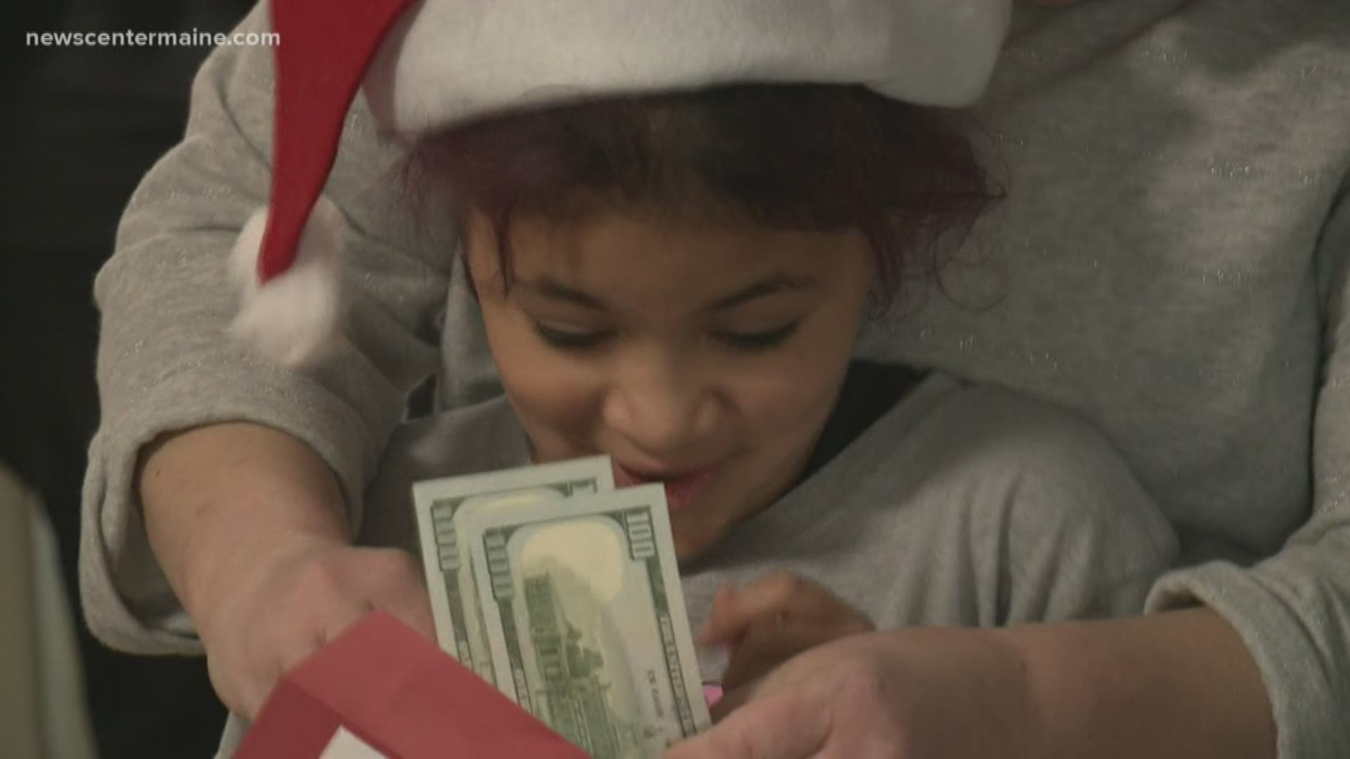 Police officers and TIP volunteers deliver Christmas cash to