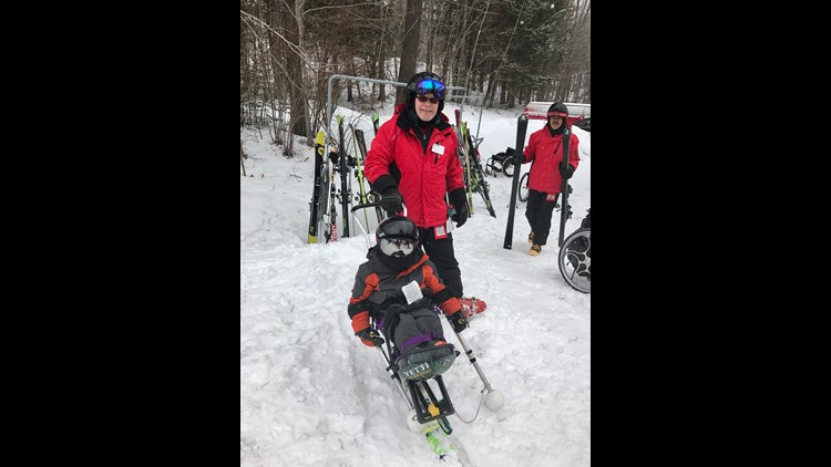 Kellan Tilton takes part in adaptive skiing.
