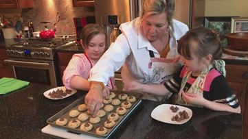 It's a family affair! Chef Lynn Archer has some help baking cookies