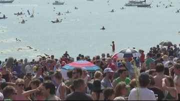 Swimmers dive into Casco Bay for the Peaks to Portland 2.4 mile swim
