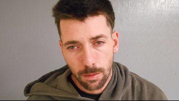 Bank robbery suspect slips on ice, spills cash, all in front of state police