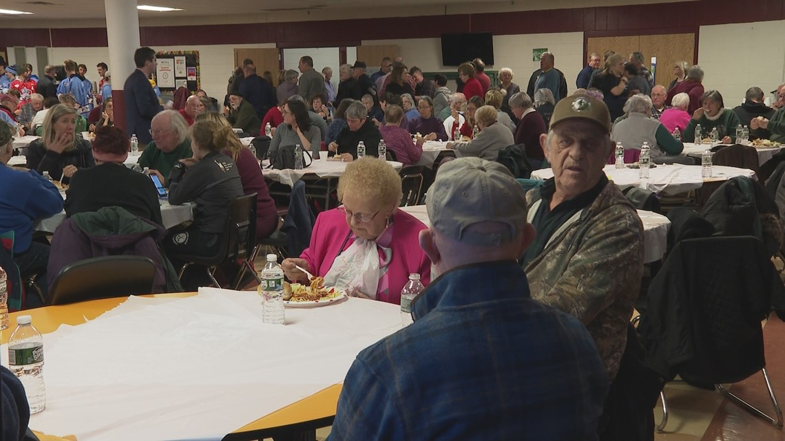 Hundreds attend benefit dinner for woman scammed of life savings