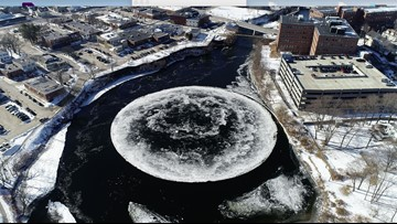 Giant ice disc floating, rotating in Westbrook's Presumpscot River