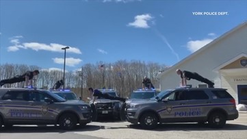 Maine police officers do push-ups on top of cruisers (and other places) to raise awareness of veteran suicide