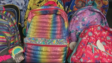 Police collect hundreds of backpacks filled with supplies ahead of school