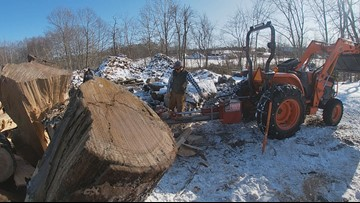 Chopping wood in the cold, so neighbors can stay warm this winter