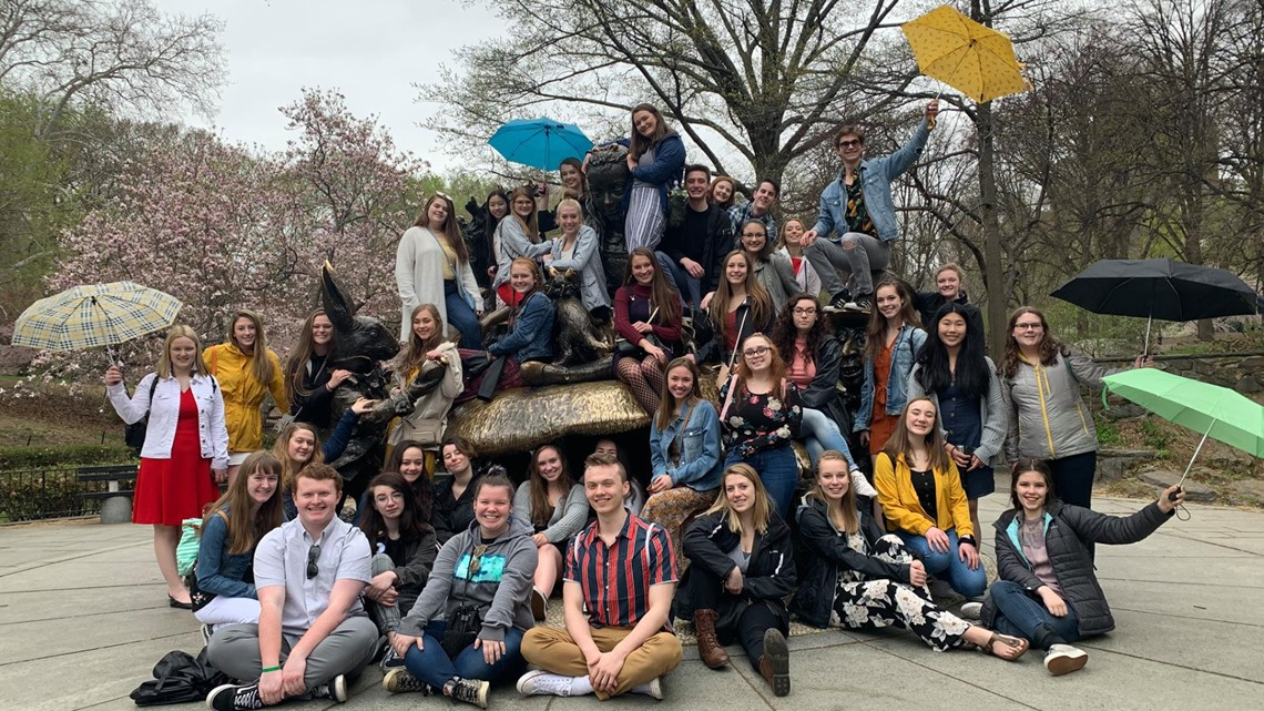 Music connecting strangers: Maine students sing with busker in Central Park