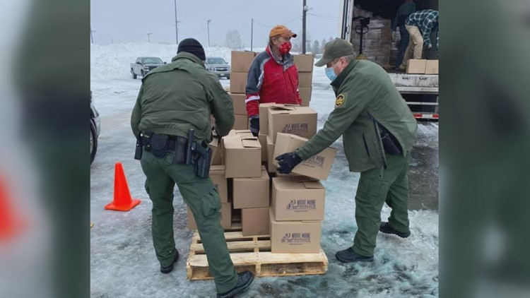 Border Patrol agents help distribute food boxes to Mainers in need in Aroostook County